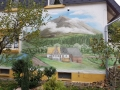 Fassadenmalerei mit Scheekoppe und Bauernhof