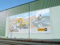 Fassadenbemalung mit Schriftenmalerei Cat Bagger