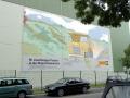Fassadenbemalung mit Schriftenmalerei Cat LKW