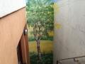 Bemalte Betonwand mit Landschaftsmalerei