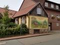 Fassadenmalerei und Lüftlmalerei mit Hirschrudel im Wald