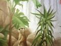Wandbemalung mit Erdmännchen im Bananenbaum