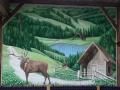 Wandbemalung mit Tier und Jagdmalerei mit Röhrendem Hirsch in den Alpen