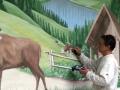 Wandmaler László Horváth beim malen