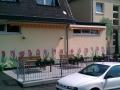 Hauswandmalerei mit Tulpen