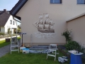 Hauswandbemalung mit Segelschiff und Wellen