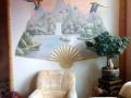 Wandmalerei thailändische Landschaft mit Papageien im Fächer