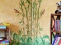 Wandbemalung mit Bambuspflanzen und Schmetterlingen